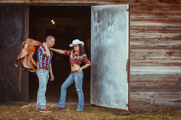 couple standing near stable