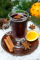 Christmas mulled wine with spices in glass, vertical