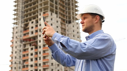 construction engineer with the tablet. pictures