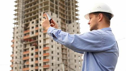 construction engineer with the tablet. take videos construction