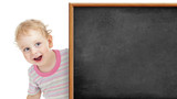 kid behind blank blackboard
