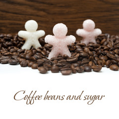 sugar in the form of little men on coffee beans, isolated