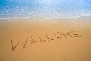 written in a sandy tropical beach
