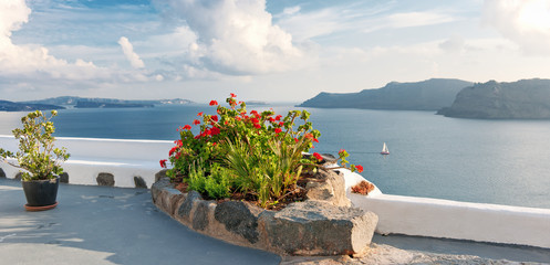 Panoramic terrace with geranium flowers overlooking the caldrea