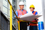 Architect and supervisor on construction site