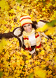Girl in autumn orange leaves, outdoor