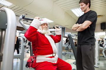 Santa with personal trainer in the gym