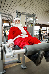 Father Christmas doing exercises in gym