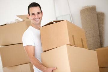 Cheerful man with cardboard box