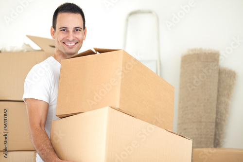 Smiling handsome man carrying packages