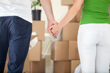 Couple holding hands together in new home