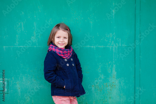 Portrait of preschooler girl outside