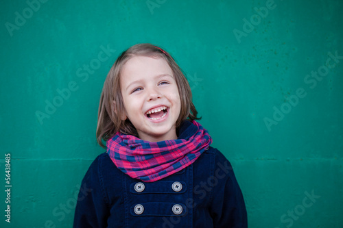Portrait of laughing preschooler girl