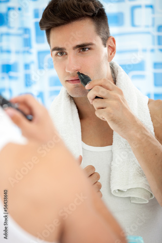 Young man with trimmer