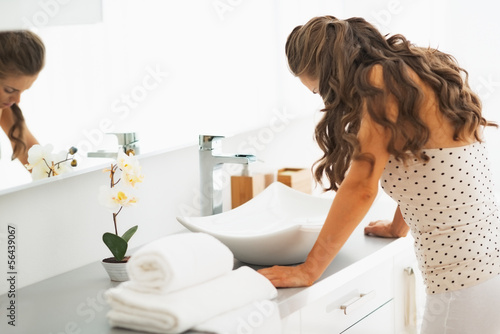 Stressed young woman in bathroom