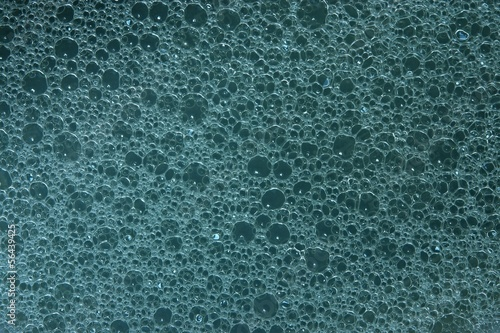 Texture of soap water on a gray-blue background