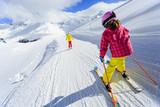 Skiing, skiers on ski run