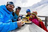 Ski - skiers enjoying lunch in winter mountains