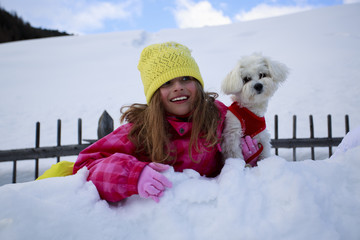 Winter - young girl with dog enjoying winter