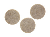 Three felt surface protectors on a white background