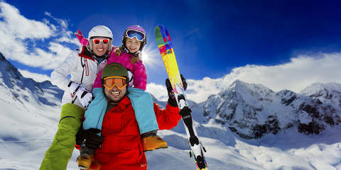 Ski ,snow, sun and fun  - family enjoying ski holiday