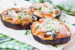 Aubergine pizza with tomato sauce, mushrooms, ham and cheese