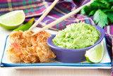 Fried shrimp in breadcrumbs and green sauce, guacamole with avoc