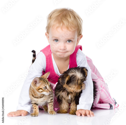 little girl with a puppy and a kitten. isolated on white