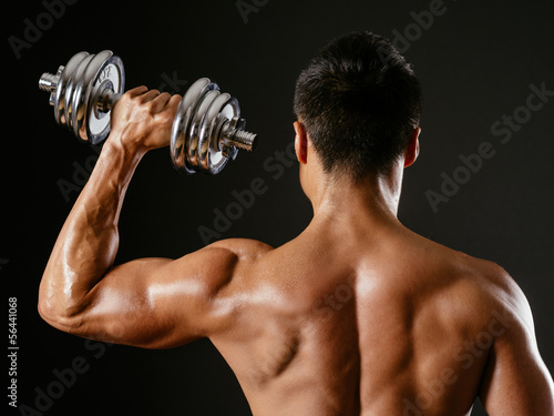 Asian male doing single shoulder press