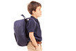 School boy with backpack standing