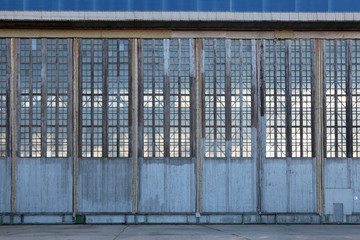 The huge gate of the assembly shop of the old aviation plant