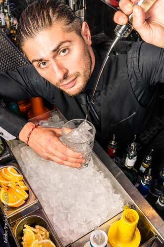 American Bartender pouring a Spirit with a smooth freestyle Move
