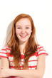 portrait of cute redheaded girl, background wall