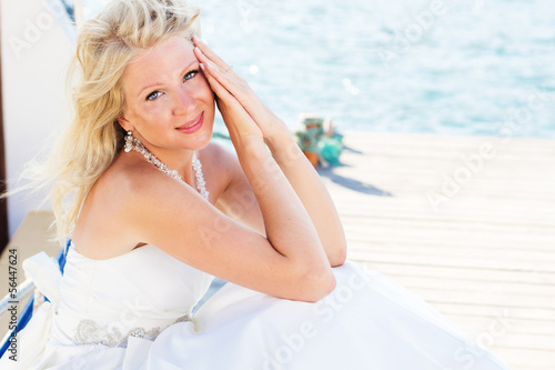 Beautiful bride posing near the sea