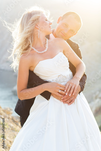 Couple in love young bride and groom dressed in white