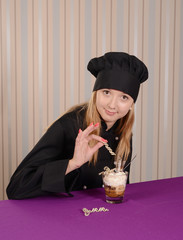 female chef conditer in black jacket decorating tiramisu dessert