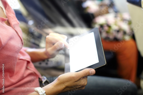 Hands with tablet computer.