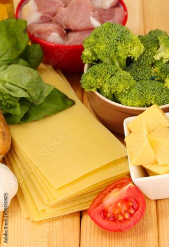 Lasagna ingredients on wooden background