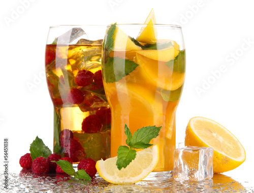 Iced tea with raspberries, lemon and mint isolated on white