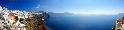 Leinwanddruck Bild Panoramic view of Santorini village and volcanic bay, Greece