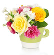 Beautiful bouquet of bright flowers in color mug, isolated