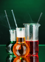 Laboratory glassware on dark color background