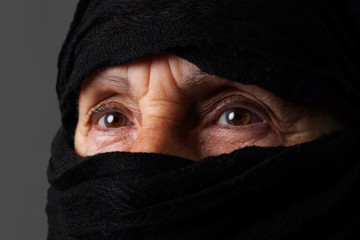Senior muslim woman eyes