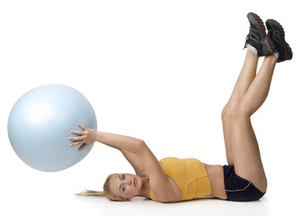 nice blond keeping a big fitness ball