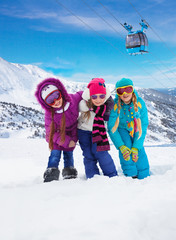 Three kids together in ski resort