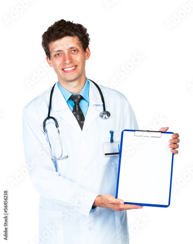 Young male smiling doctor showing clipboard on white
