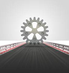 cogwheel on motorway track leading to factory