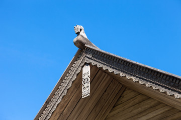 Carved wooden horse on the roof of an old Russian house
