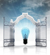 open baroque gate with bulb light and sky