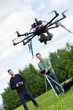 Engineers Operating UAV Octocopter in Park
